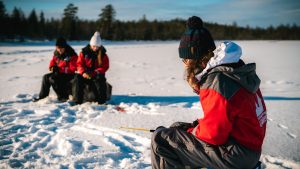 Ice fishing safari in Rovaniemi, Lapland with Christmas House Safaris