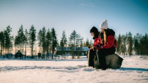 Ice fishing safari in Rovaniemi with Christmas House Safaris